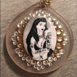 Tarina Tarantino LA city tattoo girl necklace